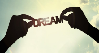 To hands holding up the word DREAM