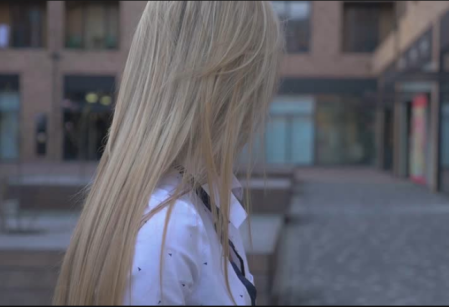 Photo of back of young woman's head, blonde hair